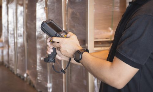 close-up-worker-holding-barcode-scanner-his-inventory-checking-warehouse-storage-computer-equipment-warehouse-management